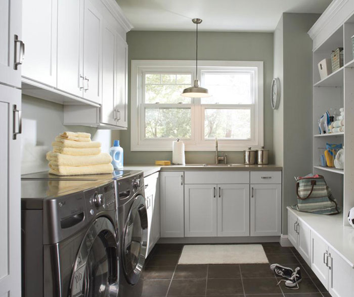Laundry room cabinets in painted white Maple by Aristokraft Cabinetry