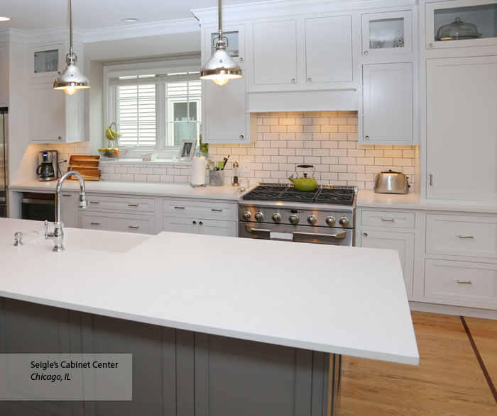 White Inset Cabinets With A Gray Kitchen Island