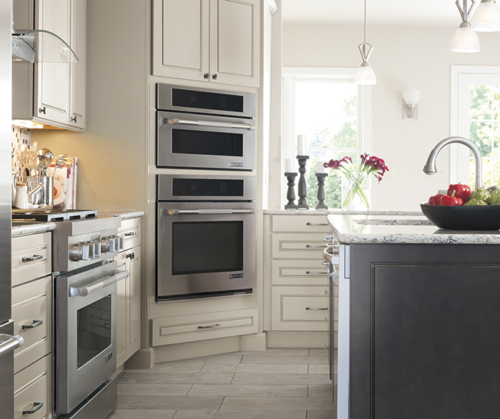 Light Gray Kitchen Cabinets with a Dark Gray Island