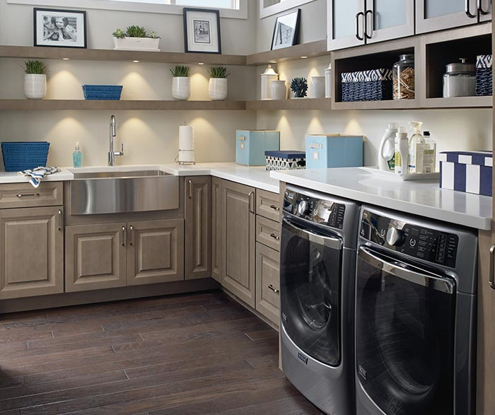Laundry room featuring Davis cabinets in Maple Seal and open shelving