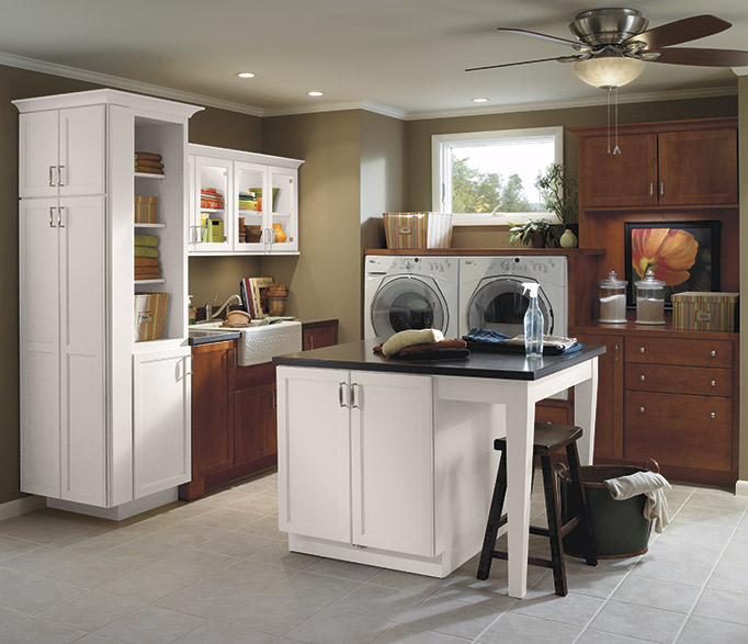 Casual laundry room cabinets in dark maple stain and white paint