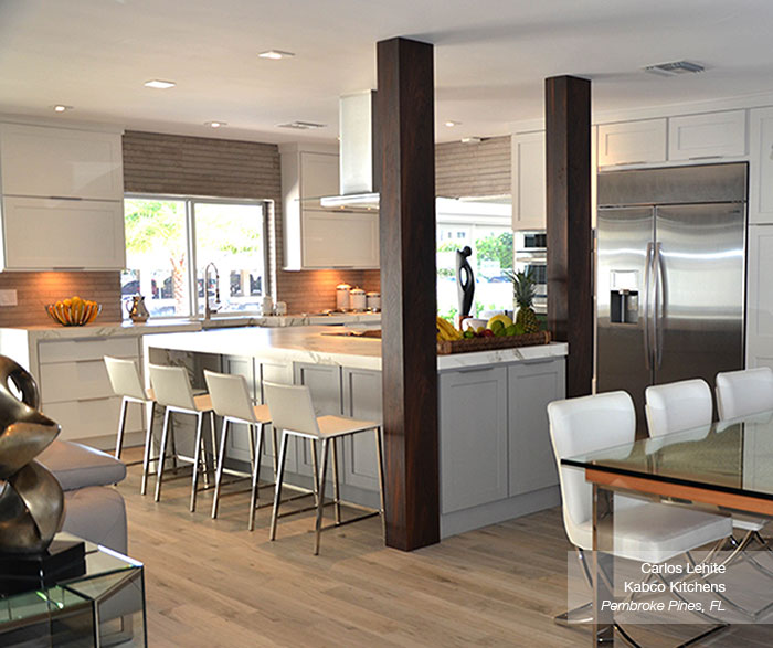 White cabinets in the Dover door style with a gray kitchen island