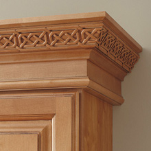 Close-up of Celtic insert in crown moulding