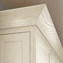 cove crown moulding on painted white oak cabinets