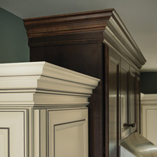 Stacked crown moulding on off white and dark stained cabinets