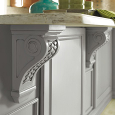 Corbels providing countertop support on a kitchen island