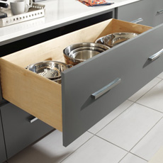 Two drawer base cabinet with top drawer open to show pots and pans storage
