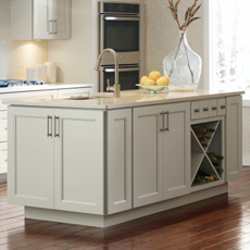 Kitchen island made up of base cabinets, including a wine storage cabinet