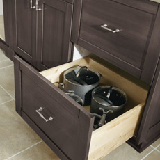 Two drawer base cabinet with bottom drawer open to show pots and pans storage