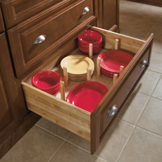 Cabinet drawer with pegged dish organizer