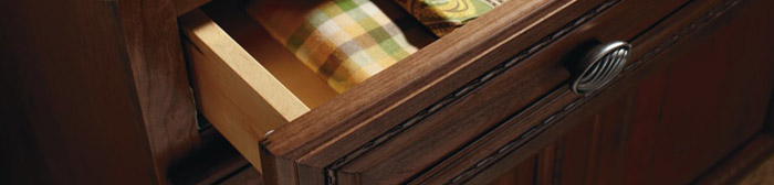 Close-up of open cabinet drawer with linens inside