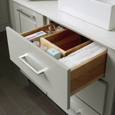 U-shaped vanity drawer opened to show interior storage