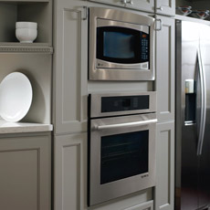 Oven And Microwave Tall Cabinet In A Painted Gray Kitchen
