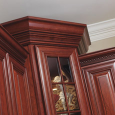 Stacked crown moulding on top of cabinets