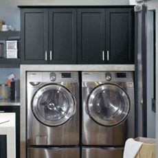 Wall cabinets above a washer and dryer in a laundry room