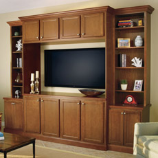Entertainment center comprised of base, wall and tall cabinets