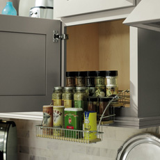 Wall cabinet with pull down spice rack in use