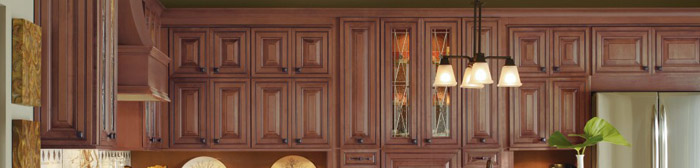 Medium tone wall cabinets in a kitchen