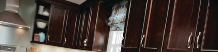 Wall cabinets in a dark brown wood stain