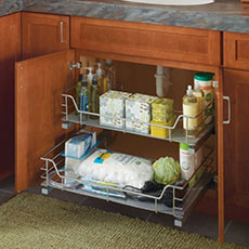 Vanity cabinet open to show chrome roll-out racks