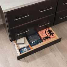 Toekick drawer in home office opened to show storage inside