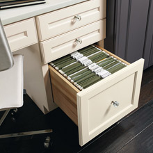 File drawer cabinet opened to show storage inside