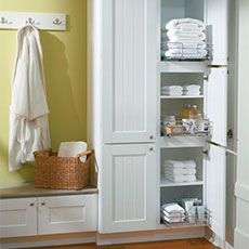 Tall Bathroom Cabinet Opened To Show Storage Capabilities