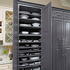 Tall kitchen cabinet open to show storage shelves