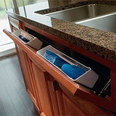 Sink base cabinet with tilt-outs opened