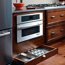 Open toekick drawer underneath oven cabinet