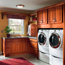 Give your laundry room cabinets a finished look by framing the washer and dryer with cabinetry.