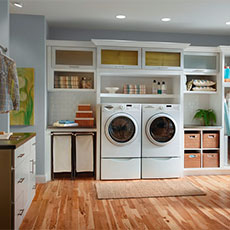 Our laundry bin storage cabinets keep supplies handy but out of sight.