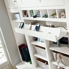 Function and convenience are designed into MasterBrand's office cabinetry, like this charging station cabinet accessory.
