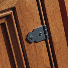 Close up of a faux hinge on a cabinet door