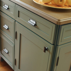 Close up of cabinets with bronze cabinet pulls, knobs and hinges