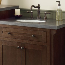 Vanity Cabinet With Bronze Cabinet Pulls And Matching Faucet