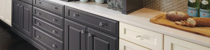Two-tone painted base cabinets with glass door knobs