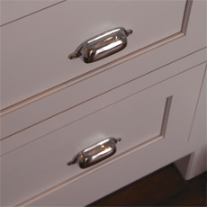 Cabinet with cup pulls in chrome finish