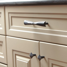 Close up of cabinet with matching pull and knobs