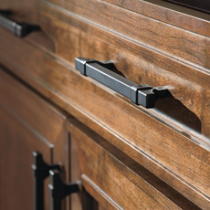 Close up of cabinet with matte black pulls