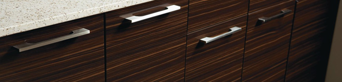 Close up of woodgrain thermofoil cabinets with contemporary pulls