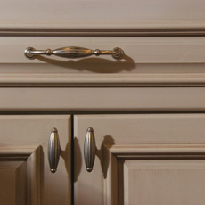 Close up of cabinet with traditional style pull and knobs