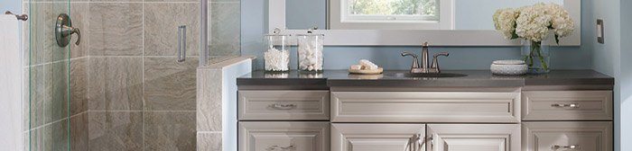 Close up of bathroom vanity cabinets in a light opaque color