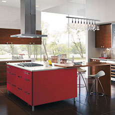 Contemporary cabinets in a modern kitchen with a red island