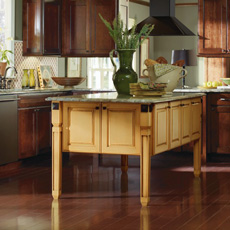 Dark cherry kitchen with painted yellow kitchen island