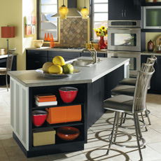 Angled black kitchen island with open shelving and seating