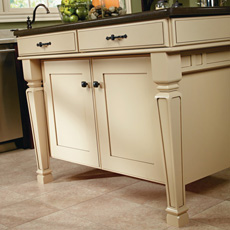 Close up of painted kitchen island with cabinet legs