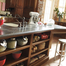 Kitchen island with open shelving and seating