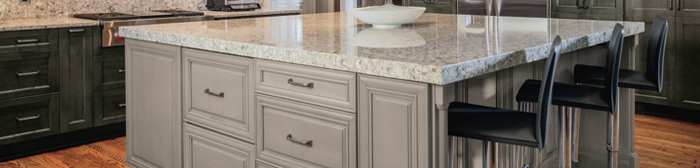 Close up of light gray kitchen island with seating