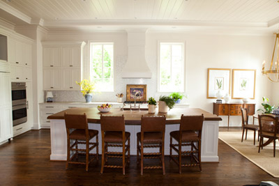 Cottage style kitchen featuring white inset cabinets by Decora